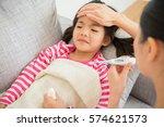 cute little asian girl is ill... | Shutterstock . vector #574621573