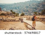 tourist man with backpack visit ... | Shutterstock . vector #574698817