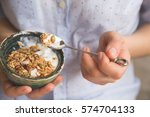 young woman with muesli bowl.... | Shutterstock . vector #574704133