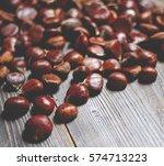 fresh chestnut on wooden table... | Shutterstock . vector #574713223