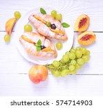 fresh fruit croissant on white... | Shutterstock . vector #574714903