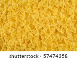 Closeup of uncooked italian pasta - farfalle - stock photo