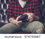 a young man is sitting on a... | Shutterstock . vector #574750087