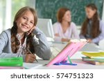 teacher with two girls at... | Shutterstock . vector #574751323
