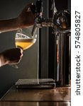 pouring beer for client. side... | Shutterstock . vector #574805827