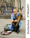 Small photo of KRAKOW, POLAND - JUNE 13: Unknown Ukrainian gusla player on June 13, 2007 in Krakow.