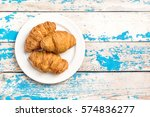 Plate With Three Croissants On...