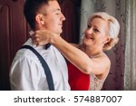 mother is helping with a bow... | Shutterstock . vector #574887007