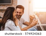young couple sitting on the... | Shutterstock . vector #574924363
