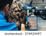 professional mechanic repairing ... | Shutterstock . vector #574925497