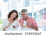 smiling mature couple enjoying... | Shutterstock . vector #574953067