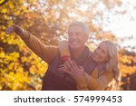 joyful couple standing against... | Shutterstock . vector #574999453