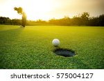 Golfer putting golf ball on the ...