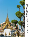 Small photo of Exterior of Rajakaranya Sapha Hall in Grand Palace, Bangkok, Thailand. Focus on tree on the foreground