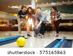friends enjoying recreational ... | Shutterstock . vector #575165863