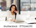 beautiful brunette using laptop ... | Shutterstock . vector #575166193