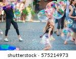 adorable little girl blowing... | Shutterstock . vector #575214973