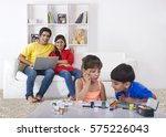 parents looking at kids... | Shutterstock . vector #575226043