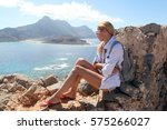 girl on the top of gramvousa... | Shutterstock . vector #575266027
