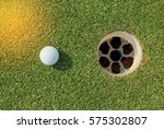 golf ball near the hole on... | Shutterstock . vector #575302807