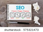 seo concept. notebook and pen... | Shutterstock . vector #575321473