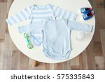 set of baby clothes on light... | Shutterstock . vector #575335843