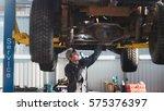 car service   a mechanic checks ... | Shutterstock . vector #575376397