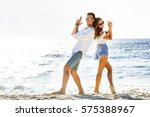 happy couple having fun at the... | Shutterstock . vector #575388967