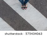 young woman feet  crossing an...   Shutterstock . vector #575434063