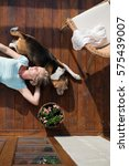 Senior Woman With Dog  Lying O...