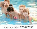 little kids in swimming pool on ... | Shutterstock . vector #575447653