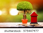 a red home model and stacking... | Shutterstock . vector #575447977