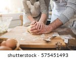 a father and his son cooking | Shutterstock . vector #575451493