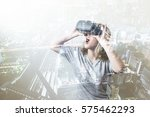 double exposure of woman using... | Shutterstock . vector #575462293