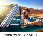 bearded guy in desert sitting... | Shutterstock . vector #575534647