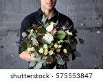A Bouquet Of Flowers In Male...