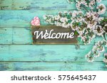 Welcome Sign Hanging On Teal...