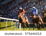 Stock photo two jockeys during horse races on their horses going towards finish line traditional european 575646313
