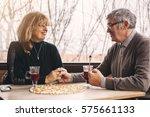 smiling senior couple holding... | Shutterstock . vector #575661133