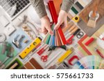 male hands holding swatches and ...   Shutterstock . vector #575661733
