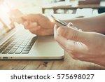 online payment man's hands... | Shutterstock . vector #575698027