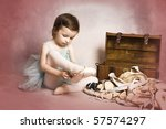 Beautiful brunette girl wearing a ballet costume on pink background - stock photo