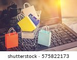 colorful paper shopping bags in ... | Shutterstock . vector #575822173