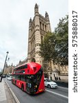 Small photo of London, United Kingdom - October 20, 2016: Cars are passing by the Palace of Westminster which is the meeting place of the House of Commons and the House of Lords in United Kingdom