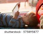 little boy reading a book on...   Shutterstock . vector #575895877