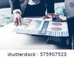 businessman analyzing... | Shutterstock . vector #575907523