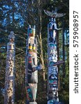Small photo of VANCOUVER, CANADA -DECEMBER 8, 2013: Mysterious Haida Indian totem poles mark the boundary of the spirit world in Stanley Park, Vancouver, Canada.