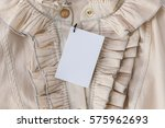tag on a beige blouse made of... | Shutterstock . vector #575962693