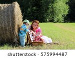 mother with twins in field | Shutterstock . vector #575994487