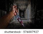 Hand Holding Knife Smeared Wit...